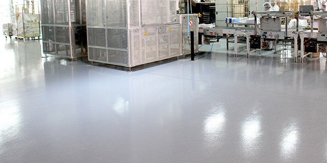 grey coloured industrial epoxy floor in factory manufacturing line