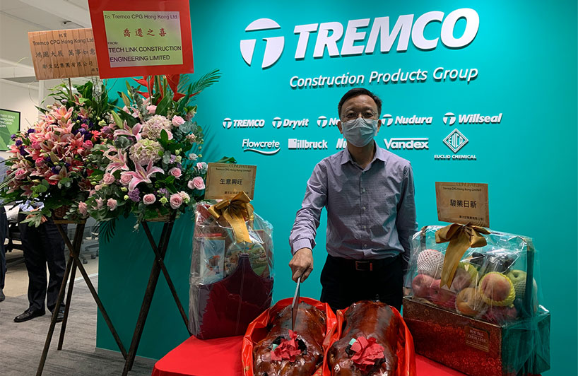Francis Tang, director of Tremco Hong Kong, celebrating the Tremco CPG office opening in the new premises in Hong
