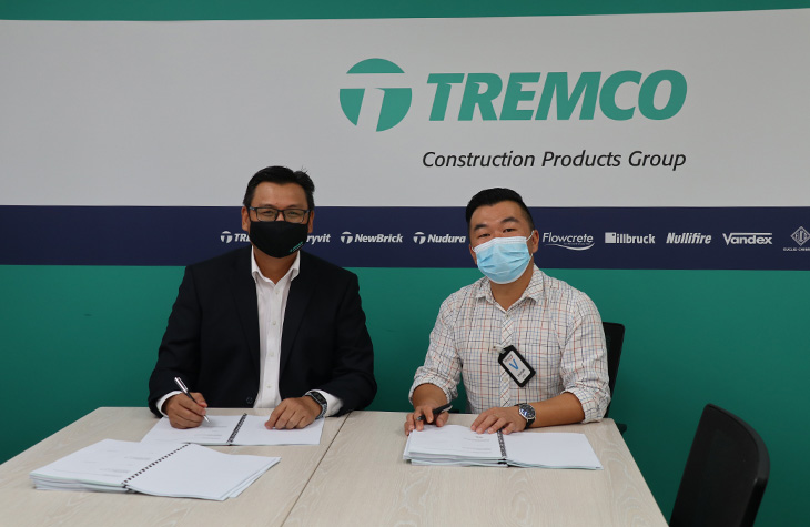 Jackson Koh of Tremco CPG, signing the documents